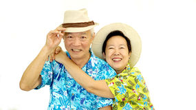 Happy Asian senior couple hugging happily wearing hat ready for Royalty Free Stock Image