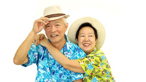 Happy Asian senior couple hugging happily wearing hat ready for Royalty Free Stock Images