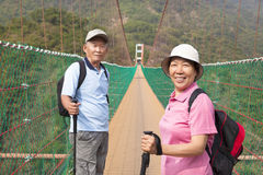 Happy asian senior couple walking on the bridge in Royalty Free Stock Image
