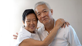 Happy Asian senior couple white background love and hug Stock Images