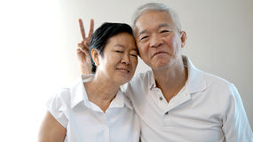 Happy Asian senior couple white background love and hug Stock Photos
