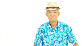 Happy asian senior guy on blue hawaii shirt laughing on white is Stock Photo