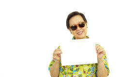 Happy Asian senior woman with hawaii green shirt holding white b. Lank sign on isolate background Stock Photos