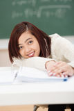 Happy Asian student relaxing in between classes Stock Images
