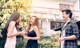 Happy asian teen celebrate about education congratulate together. At garden in home stock photography