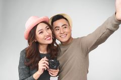 Happy asian tourists taking photo of themselves. summer holidays. Travel, vacation royalty free stock photography