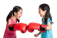 Happy Asian twins girls  with boxing gloves Stock Photo