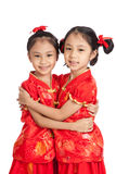 Happy Asian twins girls in  chinese cheongsam dress Royalty Free Stock Photo