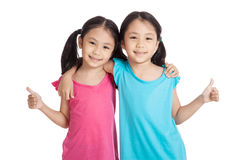 Happy Asian twins girls  smile show thumbs up Royalty Free Stock Photos