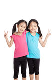 Happy Asian twins girls  smile show victory sign Royalty Free Stock Photography