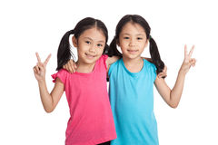 Happy Asian twins girls  smile show victory sign Royalty Free Stock Photos