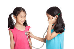 Happy Asian twins girls with stethoscope Royalty Free Stock Photo