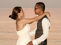 Happy Asian wedding couple in tropical location Royalty Free Stock Photography