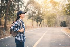 Free Happy Asian Woman Backpack In The Road And Forest Background, Relax Time On Holiday Concept Travel Royalty Free Stock Image - 111509596