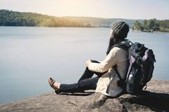 Happy Asian woman backpacker in nature winter season Royalty Free Stock Photos