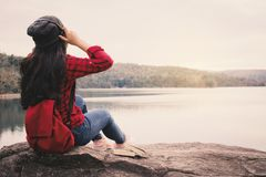 Happy Asian woman backpacker relaxing on holiday travel concept. Happy Asian woman backpacker  relaxing on holiday  travel concept,selective and soft focus,tone Royalty Free Stock Image