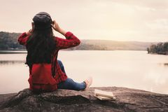 Happy Asian woman backpacker  relaxing on holiday  travel concept. Selective and soft focus,tone of hipster style Royalty Free Stock Images