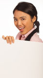 Happy Asian woman with blank sign. Happy attractive young Asian woman with a blank white sign for your advertisement or text Stock Photography