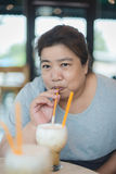 Happy Asian woman in a cafe Royalty Free Stock Photo