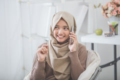 Happy asian woman calling with mobile phone Royalty Free Stock Photo