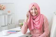 Happy asian woman calling with mobile phone Royalty Free Stock Image