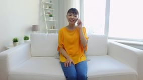 Happy asian woman calling on smartphone at home stock video