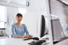 Happy asian woman with computer at office stock images