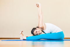 Happy asian woman doing exercise of yoga indoor at home Royalty Free Stock Photos