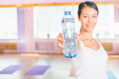 Happy asian woman after fitness exercise holding natural water Stock Image