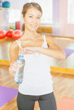 Happy asian woman after fitness exercise holding natural water Royalty Free Stock Photos