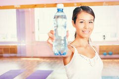 Happy asian woman fitness exercise holding natural water Stock Photography