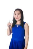 Happy Asian woman with glass of water isolated on the white back Royalty Free Stock Images