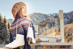 Happy asian woman going to ice skating outdoor Stock Image
