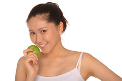 Happy asian woman with green apple Royalty Free Stock Photos