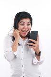 Happy Asian Woman With Her Smart Phone Royalty Free Stock Images