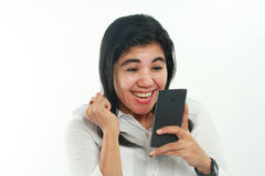 Happy Asian Woman With Her Smart Phone Royalty Free Stock Image