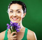 Happy Asian Woman Holding A Bouquet Of Irises Stock Image