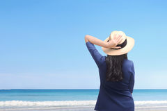 Happy asian woman holding her hat and enjoying trip Stock Photo
