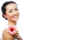 Happy asian woman holding a pink gerbera stock photo