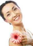 Happy asian woman holding a pink gerbera stock photography