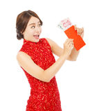 Happy  asian woman holding a red envelope with money Stock Image
