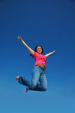 Happy asian woman jumping Royalty Free Stock Photo