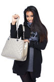 Happy asian woman looking for something in the bag Royalty Free Stock Images