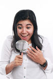Happy Asian Woman With Magnifying Glass Stock Photo