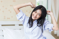 Happy Asian woman in the morning. On bed Stock Photos