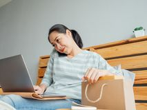 Happy woman online store owner receiving order from customer. Co. Happy Asian woman online store owner receiving order from customer. Concept of online store royalty free stock images