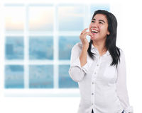Happy Asian Woman Over White. Photo image portrait of a beautiful cute young Asian businesswoman looked very excited and happy, laughing with one hand covering Stock Photo