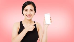 Happy asian woman on pink background, girl hold blank screen mobile phone.  royalty free stock images