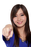 Happy Asian woman pointing finger, isolated on white Royalty Free Stock Photography