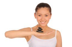 Happy asian woman with pyramid of stones Stock Photography